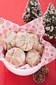 Gingerbread cookies in a dish lined with Christmas paper