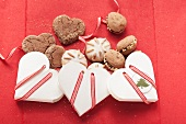 Assorted Christmas cookies with heart shaped boxes