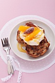Banana bread with clotted cream and oranges