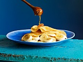 Honey flowing onto a crepe with banana slices