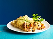 Crepes stuffed with mushrooms and gratinated with cheese