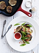 Grilled eggplant slices with halloumi