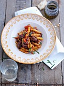 Penne with lamb sauce, tomatoes and rosemary