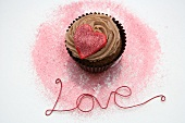 Chocolate cupcake with a red heart