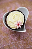 White chocolate cupcake in a heart-shaped dish