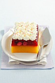 Peach-berry jelly topped with whipped cream