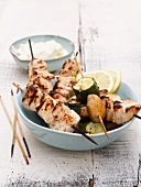 Grilled chicken kebabs and zucchini-mushroom kebabs