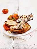 Grilled sardines and tomatoes