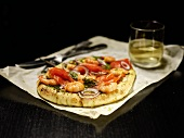 Pizza with salmon, shrimp and onions