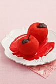 Red spiced poached apples with chocolate leaves