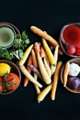 Assorted root vegetables with dishes of fruit, salad and vegetables
