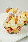 lemon and cream fairy cakes on a white plate
