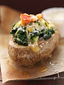 Twice-baked potato topped with cheese and spinach