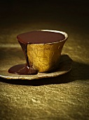 Chocolate sauce in a gold cup