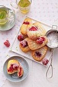 Madeleines with raspberries and limes