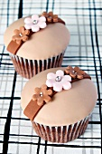 Chocolate cupcakes decorated with flowers