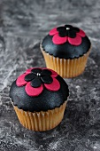 Cupcakes topped with black fondant icing