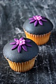 Vanilla cupcakes topped with grey fondant icing