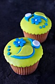Lemon cupcakes topped with colourful fondant icing