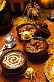 Three Halloween soups with fun Halloween decorations