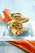 Wraps filled with vegetables, smoked turkey breast and tuna