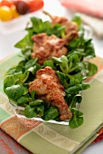 Chicken drumsticks on lamb's lettuce