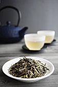 Loose Green Tea, Two Cups of Tea and Japanese Teapot, selective focus
