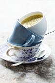 Cream of artichoke in a stack of cups