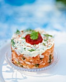 Salmon tartare topped with quark and herbs