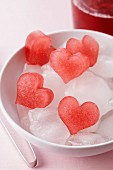 Red, heart-shaped ice cubes