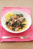 Ribbon pasta with spinach, beetroot leaves and salmon