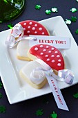 Toadstool-shaped biscuits with message tags as a gift