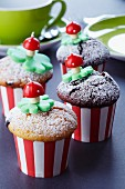 Muffins decorated with clover leaves and toadstool candles