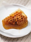 Honey with honeycomb on plate