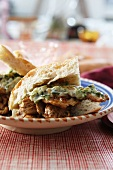 Chicken with a herb sauce in flatbread