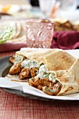 Chicken with herb sauce in pita bread