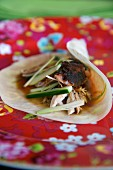 A pancake filled with duck and vegetables