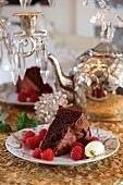 Two slices of chocolate and raspberry cake