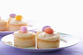 Mini cheesecakes with vanilla custard and marzipan eggs