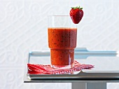 A glass of strawberry and kiwi smoothie