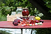 Preserved plums in jars on a table in the garden