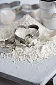 Flour, heart-shaped cutters and eggshells