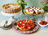 A buffet of three different summer cakes