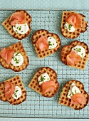 Heart-shaped waffles topped with salmon, cream cheese and chives