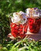 Strawberry salad with whipped cream and sugar balls
