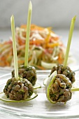 Balls of tuna tartare on lemon grass skewers