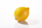 A lemon on a white surface