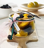 Preserved blackberries and yellow plums