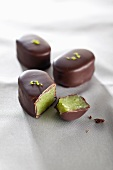 Marzipan filled chocolates with pistachios
