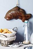 Fish-shaped cake mould decorating wall